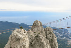 Peak. Suspension bridge, at the bottom of the sea, village, forest royalty free stock photo