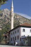 A peak of the Taurus Mountains in the background and a Mosque in the front, Elmali, Antalya, Turkey, September 27th, 2018. Elmali is located 1000m above the sea stock images