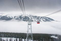 Peak to peak cable car at Whistler, Canada. Cable car running between two snow covered mountains at a ski resort Stock Photo
