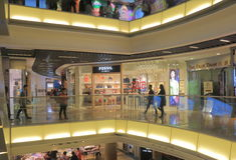 The Peak Tower shopping mall Hong Kong. People visit The Peak Tower shopping mall in Hong Kong. The Peak Tower is a leisure and shopping complex located at the Stock Photos