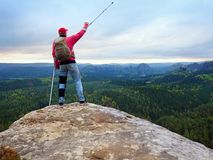 Peak triumph. Man with leg in knee cages and crutches for stabilization and walk support. Hiker use adjustable side panels to immobilize and support of hurt Royalty Free Stock Photography