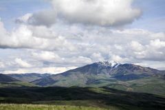 Peak with Utah Snow capped mountains with rolling green hills Royalty Free Stock Images
