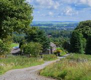 Peak Views. Beautiful English countryside. Buxton in the Peak District. Cute cottage in the foreground with rolling hills in the background Royalty Free Stock Image