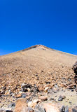Peak of the volcano Teide, Canary islands. Peak of the volcano Teide, the highest mountain in Spain, showing loose volcanic scree and a path leading to the top Stock Photography
