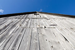 Peak of a weathered barn. The peak of a weathered barn points high into the sky Royalty Free Stock Photo