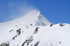 Peak in wind. A peak in wind on the Moltaller glacier, Austria Stock Photography