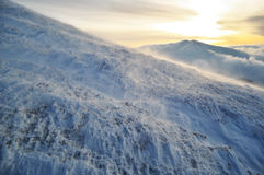 Peak of winter mountain in windy conditions Stock Photos