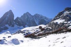 Snow mountain under blue sky stock photography