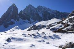 Snow mountain under blue sky stock photos