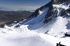 Snowmountain snow mountain under blue sky stock photography