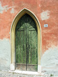 Peaked door in ancient castle. Peaked green door in the ancient castle at Goito, in Lombardy, Italy Stock Photos