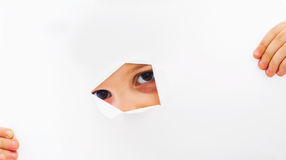 Peaking through paper hole Royalty Free Stock Images