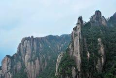 Peaks. Of stones pillar-shape facing the sky Stock Image