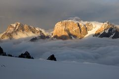 Peaks above the clouds at sunset Stock Photography