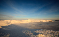 Peaks above clouds Royalty Free Stock Images