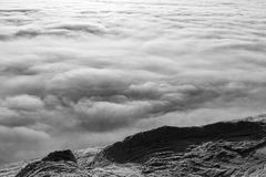 Peaks above clouds Royalty Free Stock Photo