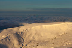 Peaks above clouds Royalty Free Stock Photos