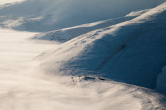 Peaks above clouds Stock Photography