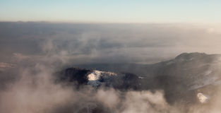 Peaks above clouds Royalty Free Stock Photography