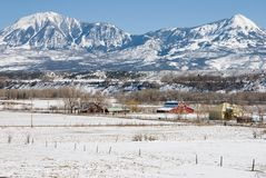 Peaks above Paonia, Colorado. Snowy double peaks loom above a farm valley near Paonia, Colorado after a late winter storm Royalty Free Stock Photos