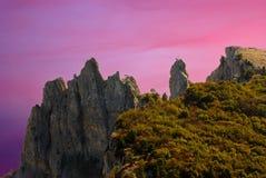 Peaks of Ai-Petri mountain at Black Sea shore. (Crimea, Ukraine) at sunset time stock photos
