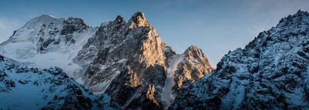 Peaks in Ala-Archa. Evening sun and peaks in Ala-Archa gorge, Kyrgyzstan Stock Photo