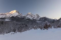 Peaks of the Almtal in Upper Austria during wintertime. The Almtal in the Upper Austrian Alps is one of the most beautiful places to be in winter. Deep snow, a Royalty Free Stock Image