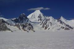 Peaks around snow lake Stock Photo