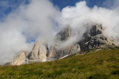 Peaks in the clouds; Sassolungo group Royalty Free Stock Images