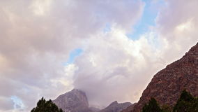Peaks in the clouds at sunset. Pamir, Tajikistan. Royalty Free Stock Images