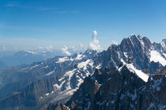 Peaks of the French Alps. Montblanc mountain in summer. Snow, rocks and beautiful clouds Royalty Free Stock Photography