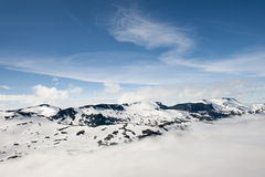 Peaks of mountains above the clouds, mountain Dalsnibba view to Geiranger fjord, Norway Royalty Free Stock Photos