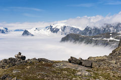 Peaks of mountains above the clouds, mountain Dalsnibba view to Geiranger fjord, Norway Royalty Free Stock Photo