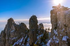 The peaks of the mountains Ai-Petri, sunny, clouds below the mountains, Crimea, Russia royalty free stock photos