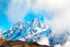 Peaks of mountains, covered by snow. Royalty Free Stock Image