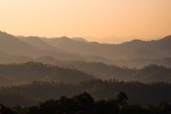 Peaks Orange. Orange sun peaks over the morning Stock Image