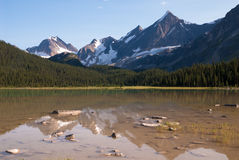 Peaks over Amethyst lake in Jasper stock photography