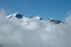 Peaks over clouds nearby Sustenpass Royalty Free Stock Photo
