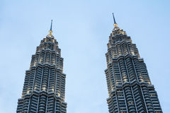 Peaks of the petronas towers. KUALA LUMPUR,MALAYSIA - JUNE 14, 2013: Twin peaks of the petronas towers in Kuala Lumpur, Malaysia.Malaysia is a member of Asean Royalty Free Stock Images