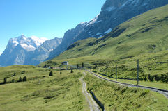 Peaks and railway tracks nearby Grindelwald in Switzerland Royalty Free Stock Images