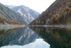 Peaks reflecting in mountain lake like in a mirror Royalty Free Stock Photos