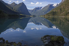 Peaks reflecting in mountain lake like in a mirror Royalty Free Stock Photo