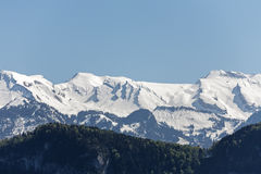 Peaks of rocky mountains covered with snow Stock Images
