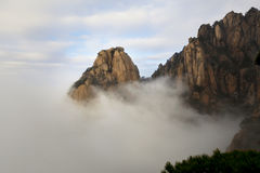 Peaks in the sea of clouds stock photography