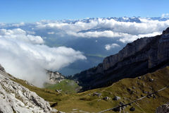 Peaks towering above the clouds Stock Photo