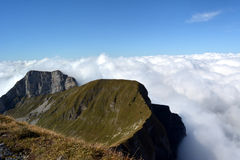 Peaks towering above the clouds Royalty Free Stock Images