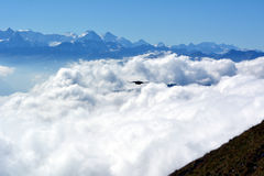 Peaks towering above the clouds Royalty Free Stock Photo