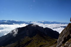 Peaks towering above the clouds Stock Photography