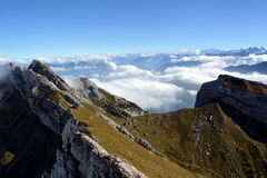 Peaks towering above the clouds Royalty Free Stock Image