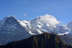 Peaks towering above the clouds Royalty Free Stock Photography